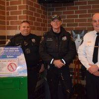 officers display their drug take back box
