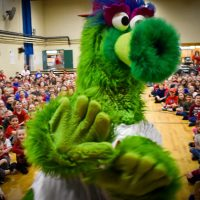 Phillie Phanatic at an assembly at Walter Miller Elementary School
