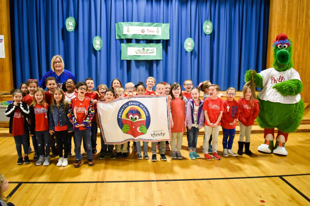 Philllie Phanatic poses with a class at Walter Miller Elementary School