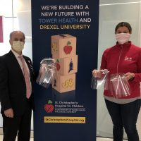 Dr.-Lindsey-Sides-of-the-Bucks-IU-Presents-PPE-Face-Shields-to-Solomon-Torres-scaled
