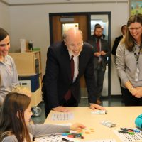 Governor Tom Wolf watches 4th grade students engage with robotics. On his left is Megan Boletta, Bucks IU Fab Lab Program Coordinator and on his right is Dr. Lindsey Sides, Bucks IU Supervisor of STEAM Education.