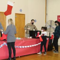 Students and staff coolect items to stuff stockings to be sent to troops stationed overseas.