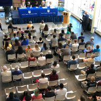overhead view of the Epstein Campus inside common area with that shows the audience and discussion panel