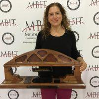 Pamela Swoyer holding award