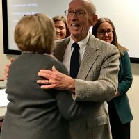 Dr. Robert Leight is hugged by a member of the Quakertown Community Education Foundation during his recongition ceremony.