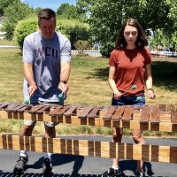 Kaitlyn Zajkowski and her dad play a marimba they made together.