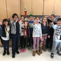 The 3rd Grade Khan Academy Winter Break Champs with their trophy.