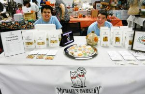 Michael's Barkery display craft fair display table showing gourmet pet treats
