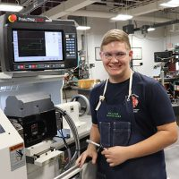 UBCTS Senior Ray Slifer standing by a machine.