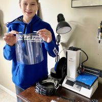 Strayer 7th grader Derek Calvello shows the kinds of personal protective equipment he's made with his 3D printer.