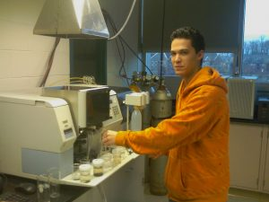 student standing in front of absorption spectrometer