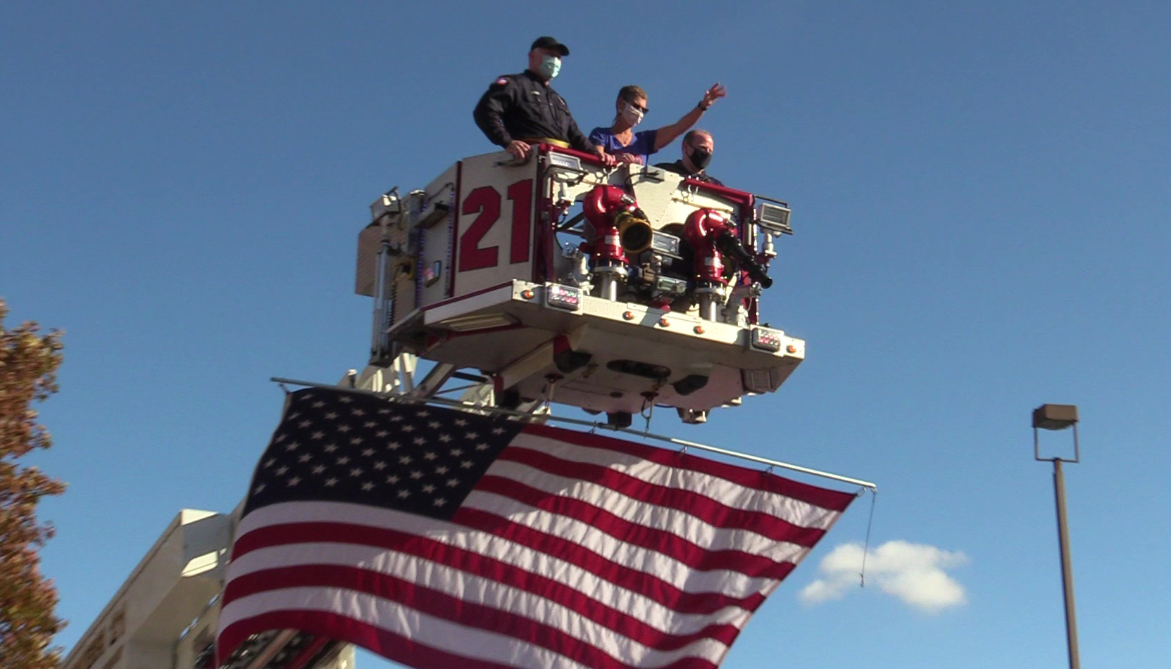 Anne Schmidt on a fire truck with firefighters