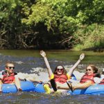 Four youth in tubes floating on the Delaware River.
