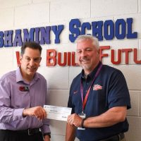 Dr. McGee accepts a donation from Giant Supermarket rep