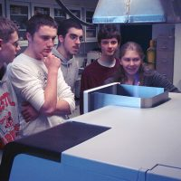 5 students standing in front of metal box