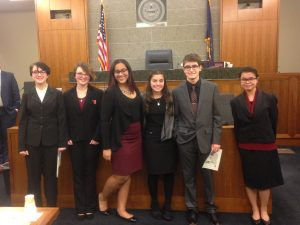 picture of 6 students in a courtroom