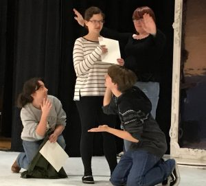 photo of students on stage acting